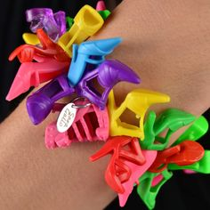 Sara gallo repurposed plastic pumps jewelry. Barbie would be proud