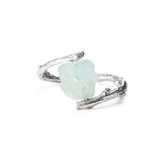 This is an enchanted ring. Its sterling silver band is hand-cast by jewelry artist Nancy Nelson from a green twig found in the ancient woods of West Virginia. Rather than the hard formality of a cut stone, it holds a rough-hewn nugget of aquamarine.