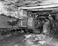 Coal miner operating a cutting machine in a coal mine