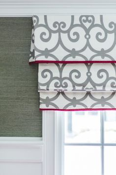 Custom cornice & Roman shade (perfect detail in match of pattern between the two)