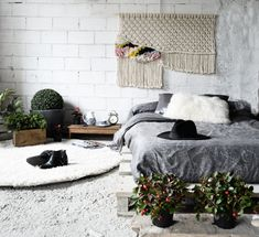 Bed on palette board base and gray bedding