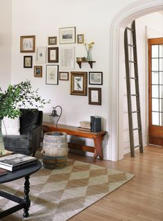 I love the thrifted gallery wall, checkered rug, and ladder in this living room makeover! White Wall Paint, Wall Paint Colors, Interior Wall Colors, Build A Fireplace, I Spy Diy, Room Wall Painting, Interior Decorating, Interior Design, Family Room