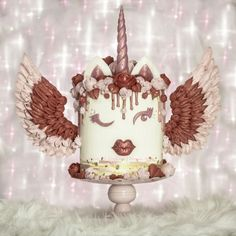 Valentine Unicorn Cake by With Love & Confection   Veronica Arthur ~Originator of the 'meringue wing' version of the already popular unicorn cake. I didn't invent the unicorn cake, I just gave it wings! <3  Meringue Wings, meringue roses and hearts. Red Velvet cake and white chocolate buttercream.  I style and shoot my cakes and create real bokeh. All in camera effects. No fake bokeh back grounds.  #UnicornCake #Unicorn #ValentinesDay #Valentine #ValentineCake