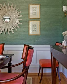 grasscloth | Lovejoy Designs. I love the wallpaper (Im assuming it's wallpaper) and the choice of red chairs. really pops!