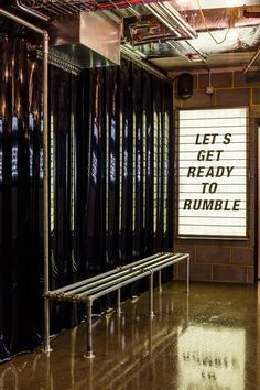 1Rebel gym has been fitted with neon lighting, black walls and a pop-up bar to feel like a nightclub.