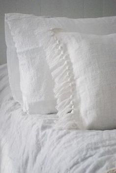 Linen...I adore an all white bed! That's what we have in my beloved husband and my bedroom. SOOOO romantic!