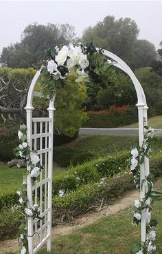 wedding arch decorations ideas | White lattice arch shown in photos above. Flowers available in a few ...