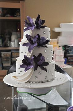 not crazy about the huge jewels, but i like the draping of the icing. and with the bright orchids... lovely.