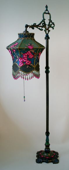 painted bridge lamp holds a Cherry Blossom Lantern shade dyed green to blue and covered in vibrant fuschia colored vintage silk cherry blossom appliques and gold mesh. The bottom is adorned with fancy little flower beads. This shade would also work Victorian Lamps, Antique Lamps, Antique Lighting, Vintage Lamps, Chandelier Lamp, Chandeliers, Lace Lamp, Lampe Art Deco, I Love Lamp