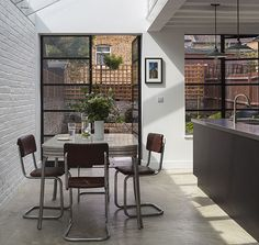 How a grim Victorian terrace in Peckham became a much-loved family home VCDesign loves this side return extension Black crittal style doors and bagged brickwork House, Home, Victorian Homes, Modern Kitchen, New Homes, Victorian Kitchen, Home Kitchens, Storey Homes, Victorian Terrace