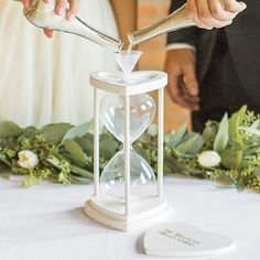 Wedding unity sand ceremony hourglass personalized with the bride and groom's married name and wedding date in choice of gold or silver print for wedding unity sand ceremony.
