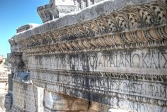 Ancient inscriptions on stone at the ruins of Ephesus in Turkey