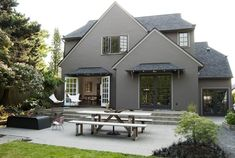 Exterior .. Stucco color .. Stupendous Stucco decorating ideas for Engaging Exterior Traditional design ideas with Adirondack chairs black roof brown exterior brown house butterfly chairs concrete fire