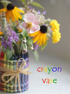 Hot glue crayons to an old soup can and make a cheerful vase
