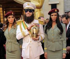 'The Dictator' left his mark on the Oscars red carpet before being escorted away by security officials.    Sacha Baron Cohen dressed as the title Mommar Gadhafi-esque character of his upcoming movie - The Dictator - defied the Academy's warnings not to show up in costume and then went one step further.    Read the story: http://www.globalnews.ca/Pages/Story.aspx?id=6442589191