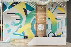 Minneapolis Bouldering Project; Lilianne Steckel Interior Design; industrial design; gym design; mural; colorful art wall; reception desk; reception lobby design; interior design; bouldering gym; wood and white; waterfall countertop; desk design; lighting design; contract design.