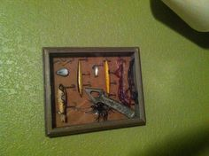 Lures and other fishing gear superglued to a shadow box. #hunting #little boys room