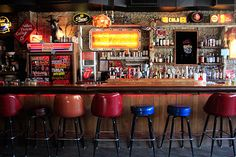 What about mismatch stools? Brought to you by the friendly gents who started everyone's favorite craft beer dive bar, Lucky Dog, Skinny Dennis Brooklyn Beer, Country Bar, Country Music, Country Roads, Bar Interior Design, Honky Tonk, Cafe Bar, Pub Bar, Bar Lighting