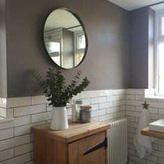 So pleased with our finished bathroom.... White subway tiles, charcoal floor tiles and my favourite Farrow and Ball colour on the walls.. Mole's Breath