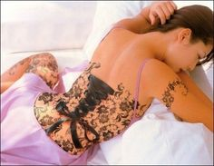 @Linda Fitzgerald   ... piercings and tatts and corsets. its ALL you :) terrikau