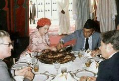 Queen Elizabeth eats with her hand with former King of Morocco Hassan II. Dont have date. Morroco