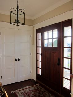Love this entry way.  Door is gorgeous and the lighting is beautiful.