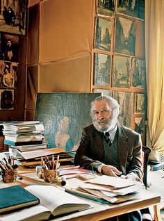 Renzo Mongiardino at his home in Milan, which also served as an office and workshop. Paintings, drawings and samples always covered the walls of his office (photo © Antoine Bootz). Top: Mongiardino enlarged the original entrance corridor of the Mondadori residence in Milan to create a dual gallery and library space, which he adorned with faux marquetry (photo by Guido Taroni, courtesy of Cabana magazine).
