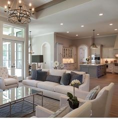 Large living room with coffered ceiling, stone fireplace, dark ...