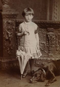 Girl with umbrella with her dog, 1885.