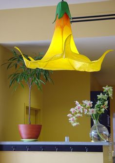 A stunning floral chandelier by HiiH Lights. These lighted sculpture artists create diverse commissioned lighting work from fanciful and colorful, to minimal and elegant. Contact the gallery to create the chandelier of your dreams! www.artxchange.org