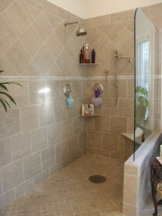 Bathrooms on Pinterest. Pony wall with glass.  Two showerheads.  Tile large below, different above a border.