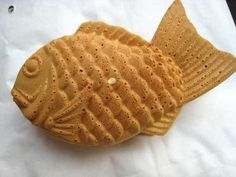 Gotta try this sweet snack when you visit Japan. It's called Taiyaki and it has sweet bean paste inside of the bread shell. It's cheap, too.