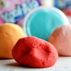 This homemade Play Dough Recipe is super soft and smells delicious!  That's right we are sharing today my favorite homemade Kool-Aid Play Dough Recipe today! How fun is this? This is an awesome and easy recipe. Your kids will love it and it is a perfect activity for the weekends and school breaks. The colors come from …