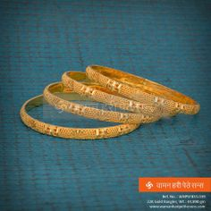 Look gorgeous with these golden bangles. Silver Jewellery Indian, Golden Jewelry, Golden Bangles Indian, Gold Bangles Design, Gold Jewellery Design, Gold Finger Rings, Weird Jewelry, Bridal Bangles, Jewelry Design Earrings