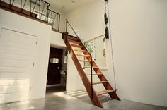 view of pull-up attic-style stairs from the other room... so here's how i can pull off the efficiency kitchen below (where darkroom is located here), bathroom alongside, with optional access to the loft/bed/nook above...  i love pinterest!!!!!!!!