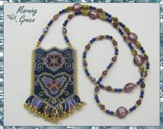 This bronze peyote stitch amulet bag was made using bronze and silver matte delica seed beads. The glass cabochon is beautiful with wonderful glimmers of amethyst and gold. It is embellished with a seed bead bezel and woven onto the center of the amulet.  The fringe is embellished with 8/0 hex-cut seed beads and Swarovski crystals.  The necklace is made using the same beads from the amulet bag and fringe woven together using herringbone stitch.  The amulet bag measures 2 1/4 inches high by…