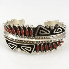 "Billy Betoney, Sterling Silver Cuff Bracelet with Bent Wire and Applique Designs and set with Coral Needlepoint. 1"" Cuff Width 4.875"" Inside Measurement, plus .75"" opening (5."