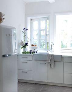 "This white and bright kitchen is from our feature ""Out of the Ordinary"""