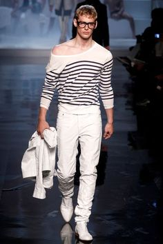 "A male model in Gaultier's signature ""Breton"" stripe."