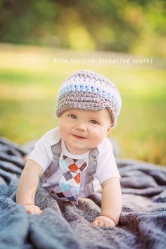 Adorable baby picture.  Loving the suspenders and tie.