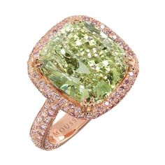 6.51cat natural fancy yellowish green diamond ring, central stone is a top quality, highly unusual natural fancy yellowish green VS2 cushion-cut diamond weighing 6.51cts. Band and setting adorned with pink diamonds, in 18k rose gold by Moussaieff.
