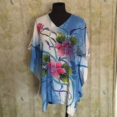 """Silk Blend Floral Tunic 28"""" long, 15"""" from neck to end of sleeve. There is no size on the tag, would fit as a medium / large.  Purchased on a trip to Korea but never wore it so I am depleting all items from my closet that I have never worn.  My loss is your gain Faruzzi Malaysia Tops Tunics"""
