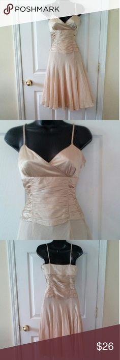 "Nine West gold 100% silk dress sz 2 Beautiful dress with spaghetti straps. 15"" armpit to armpit 14"" across waist 38"" length Nine West Dresses"