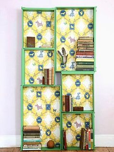 This DIY bookcase is actually drawers from an old dresser. Put wallpaper to line the insides,  nail/screw the drawers together, and viola, you've got a bookcase