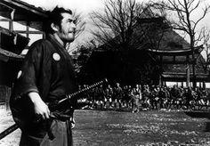 toshiro mifune as ronin sanjuro, arrives at a town/village, yojimbo ...
