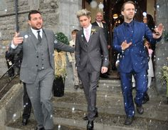 Niall walking out of the church with Paul.