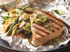 If you're looking for a no-fuss fish recipe that you can grill, then this is it! With the Gingered Tuna and Pouch Grilled Vegetable Toss, you'll cook the fish and vegetables, then remove the grilled items from the pouch when it's ready to serve. Easy Fish Recipes, Tuna Recipes, Grilling Recipes, Seafood Recipes, Grilled Tuna, Homemade Sauce, Grilled Vegetables, Food For A Crowd, Fish And Seafood