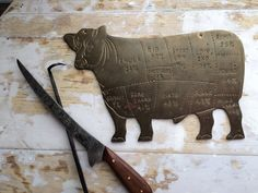 A personal favorite from my Etsy shop https://www.etsy.com/listing/267272439/vintage-brass-butcher-cow-meat-location