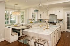 The banquette plays into the charm of the timeless, dreamy white kitchen