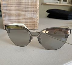 Prada SPR color Like new. Never worn. Very small imperfections. Grey lenses with silver mirror. Women's shield. Prada Sunglasses, Lenses, Im Not Perfect, Silver, Mirror, Grey, Women, Color, Style